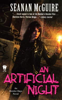 "A woman with pointed ears holding a bright candle, illuminating the stonework around her. The words read ""Seanan McGuire, ...should appela to fans of Jim Butcher's Dresden Files...Charlaine Harris, Patricia Briggs... - Library Journal, An Artificial Night, An October Daye novel."""