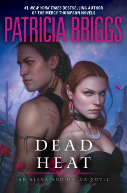 "A man and a woman stand back to back, the words read ""#1 New York Times Bestselling Author of the Mercy Thompson novels, Patricia Briggs, Dead Heat, An Alpha and Omega Novel."""