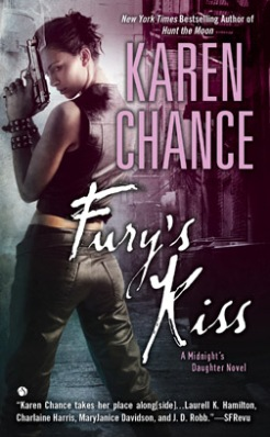 "A woman holds a gun. The words read ""New York Times Bestselling Author of Hunt the Moon, Karen Chance, Fury's Kiss, A Midnight's Daughter Novel."""