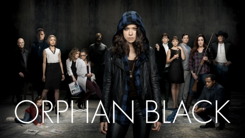 "A cast of people spread out in a dark room, the words ""Orphan Black"" written over the image."