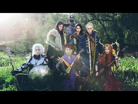 A party of adventurers, arrayed in front of a forest clearing.