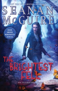 "A woman stands in a forest, with butterflies flying around her. The text reads ""New York Times bestselling author Seanan McGuire, Hugo Award nominated series, The Brightest Fell, an October Daye novel"""