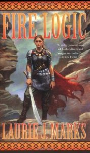 """A woman with a sword standing before a canyon. The words read """"Fire Logic, """"A deftly painted story of both cultures and magics in conflict.""""--Robin Hobb, Laurie J. Marks""""."""