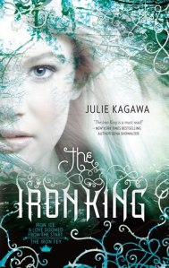 """A woman in a forest. Text reads """"Julie Kagawa, 'The Iron King is a must read!' - New York Times Bestselling Author Gena Showalter, The Iron King, Iron. Ice. A love doomed from the start. The Iron Fey."""""""